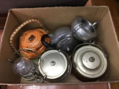 A collection of biscuit barrels and a pewter tea set