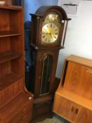 A Jaycee reproduction oak long case clock