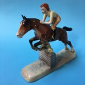 A Beswick figure group girl on a jumping horse