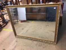 A large gilt framed mirror