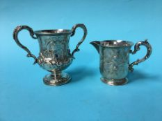 A silver jug and a cup, 10oz