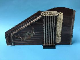 A boxed table harp
