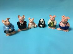 A set of five Wade NatWest piggy banks and one other