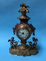A reproduction brass mounted mantle clock