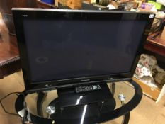 A Panasonic TV, with remote ( in office )