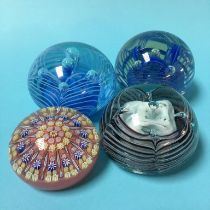A collection of four paperweights