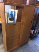 An oak gents wardrobe