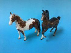 Two Beswick horses