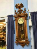 A walnut wall mounted Vienna regulator twin weight wall clock