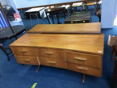 A teak chest of drawers and dressing table