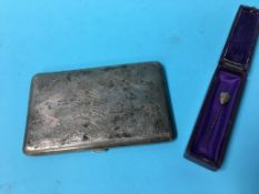A cigarette case marked 'silver' and a coloured pin