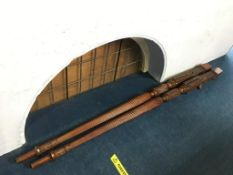 A pair of mahogany bed posts