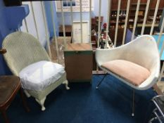 Two Lloyd Loom chairs and a linen basket