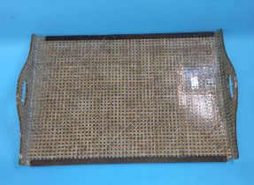 A Christian Dior lucite and rattan serving tray