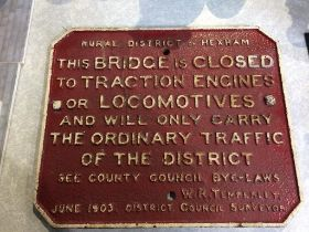 A cast iron sign, dated June 1903