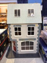 A dolls house modelled as a Pub 'The Last Orders', with contents