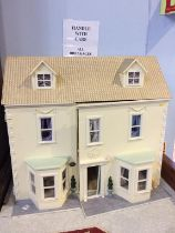 A dolls house and contents