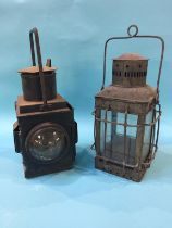 A railway lantern and one other