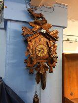A Cuckoo Clock, approx. 53cm x 31cm