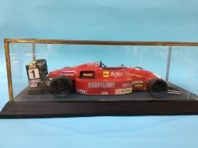 A cased model racing car, Case 59cm wide x 25.5cm deep x 18cm high (excluding plinth)