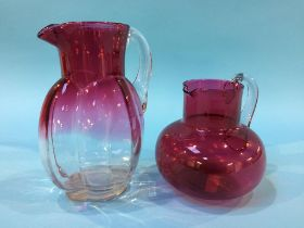 Two Cranberry glass jugs