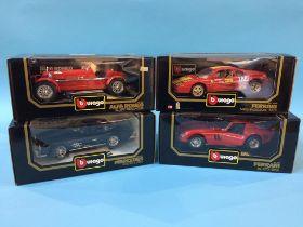 Four boxed Burago Die Cast cars