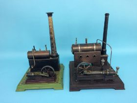 Two spirit fired model engines, labelled 'Made in Germany', 28cm width x 33cm height