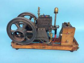A Perkins Hopper Fed horizontal engine, stamped ' Genuine Trade Mark K-W, Made in USA', 48cm length,