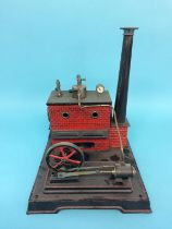 A model spirit fired engine stamped D. C., 25cm width x 31cm height