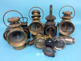 A box of nine various railway and other lamps