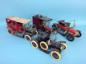 A box containing four model vintage vehicles
