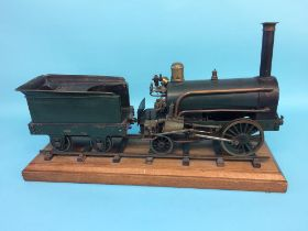 A 3 ½ inch gauge live model of an early steam locomotive, 2-2-0, with green livery