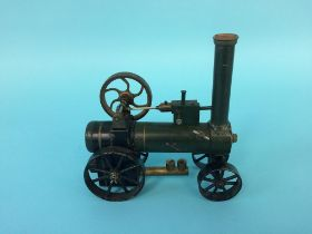 A miniature traction engine, 14cm wide, 14cm height