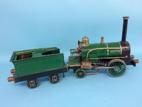 A live 3 ½ inch gauge model locomotive and tender, 'Rainhill', with green livery, 13cm width x