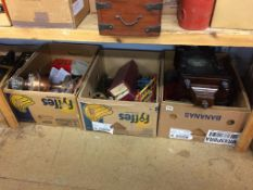 Three boxes of assorted, to include a mantle clock, model bits, and an oil lamp etc.
