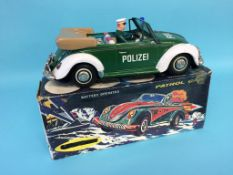 A battery operated 'Polizei' VW patrol car (boxed)