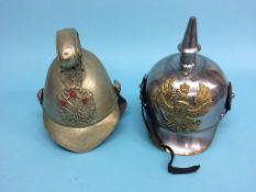A replica German helmet and a Fireman's helmet