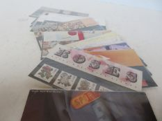 18 presentation packs of mint stamps