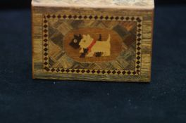 A marquetry box decorated with Scottish Terriers