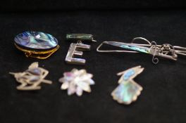 3 silver and abalone shell brooches together with