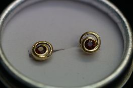 A pair of 9ct gold stud earrings