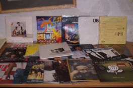 A collection of LP's to include- Queen, UB40, Abba