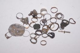 Collection of metal detector finds - rings & fobs