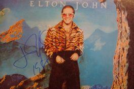 Elton John signed Caribou album. Signed in blue ma