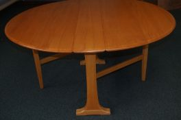 Blonde Ercol Dropleaf table - 72cm High and 140cm