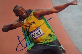 Signed Photograph of Usain Bolt, COA and COA Stamp