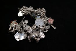 Heavy Silver Charm Bracelet with many Charms - 130