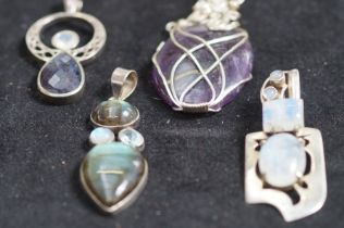 4x Silver and Glass Pendants