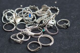 Large Collection of White Metal Rings