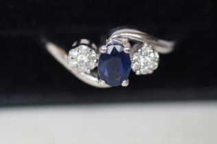 9ct white gold ring set with diamonds and sapphire